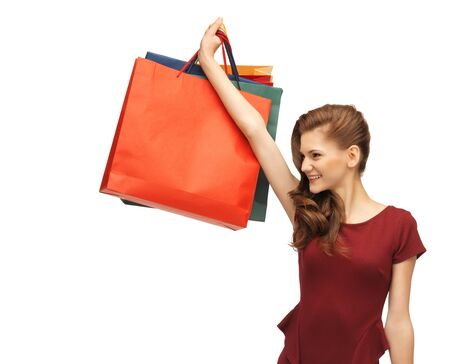 picture of teenage girl in red dress with shopping bags Stock Photo - 16734250