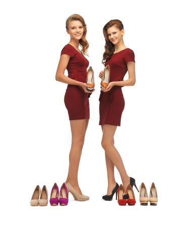 picture of two lovely teenage girls in red dresses with shoes photo