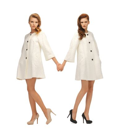 picture of two lovely teenage girls in white coats Stock Photo - 16734237