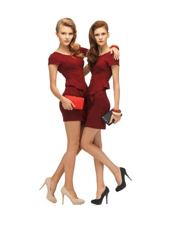 clutches: picture of two teenage girls in red dresses with clutches
