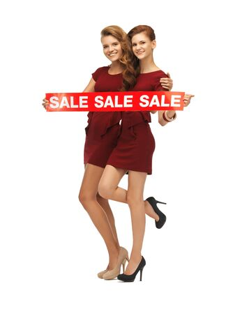 picture of teenage girsl in red dresses with sale sign Stock Photo - 16734224