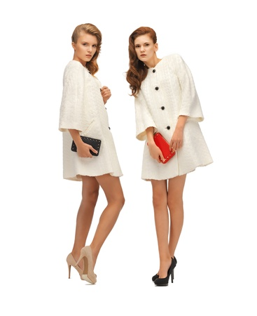 clutches: picture of two teenage girls in white coats with clutches