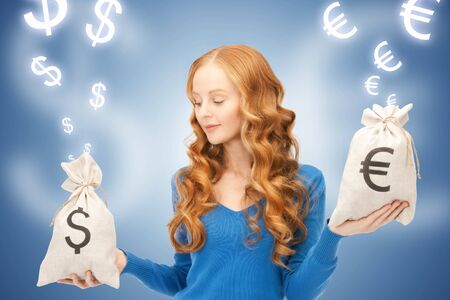 money bags: picture of woman with euro and dollar bags