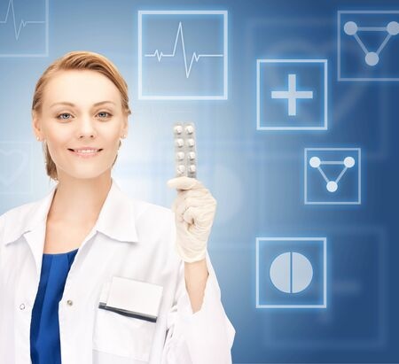 contraception: picture of attractive female doctor with pills