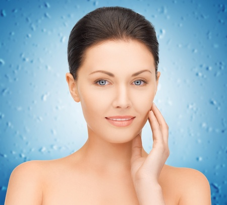 hydration: portrait picture of beautiful woman with water drops Stock Photo