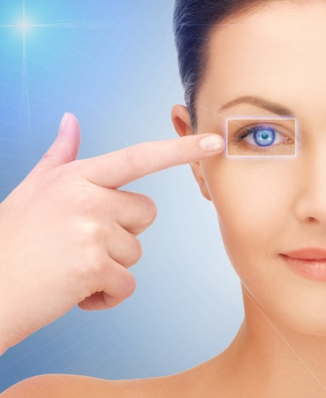 picture of beautiful woman pointing to eye Stock Photo - 16796913