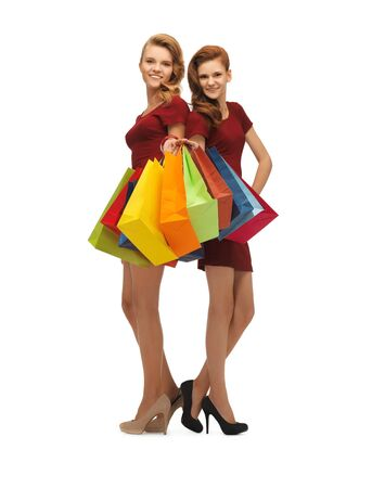 picture of two teenage girls in red dresses with shopping bags Stock Photo - 16812984