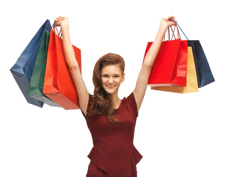 picture of teenage girl in red dress with shopping bags Stock Photo - 16813734