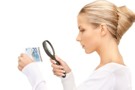 spurious: beautiful woman with magnifying glass and euro cash money