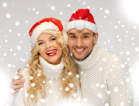picture of family couple in sweaters and santa s hats Stock Photo - 16838871