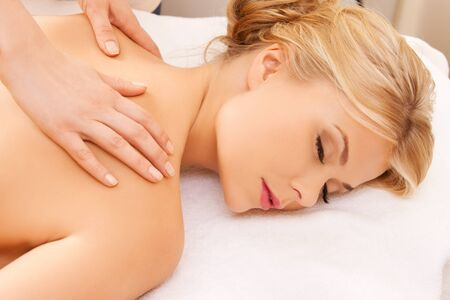 dayspa: picture of calm beautiful woman in massage salon Stock Photo