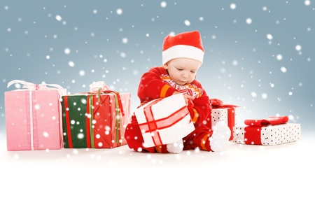 picture of santa helper baby with christmas gifts photo