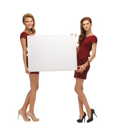picture of two teenage girls in red dresses with blank board Stock Photo - 16848145