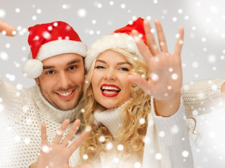 picture of family couple in sweaters and santa s hats Stock Photo - 16848086