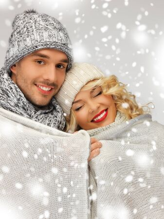 bright picture of family couple under warm blanket photo