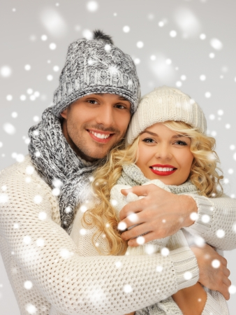 winter woman: bright picture of family couple in a winter clothes Stock Photo