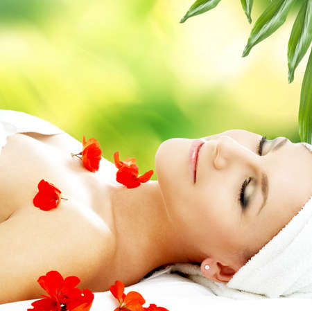 lovely woman with red flower petals in spa Stock Photo - 16880362
