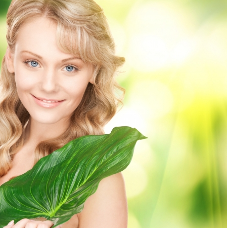 picture of happy woman with green leaf Stock Photo - 16969585