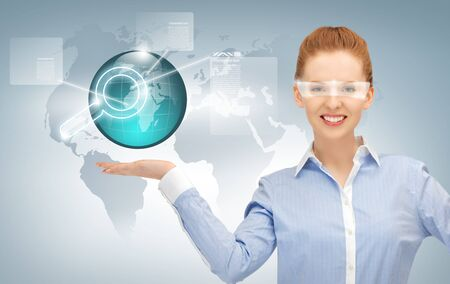 smiling woman showing virtual earth globe on the palm of her hand Stock Photo - 16880089
