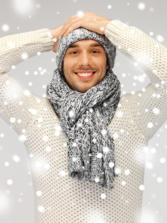 head wear: picture of handsome man in warm sweater, hat and scarf. Stock Photo