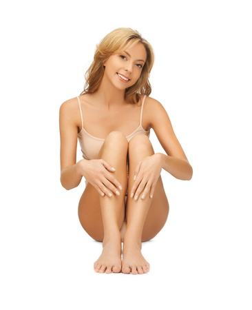 chiropody: picture of beautiful woman in cotton undrewear touching her legs Stock Photo