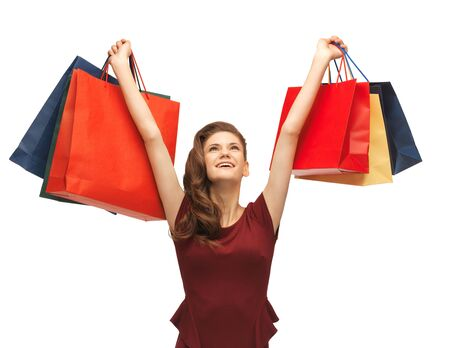 picture of teenage girl in red dress with shopping bags Stock Photo - 16880098