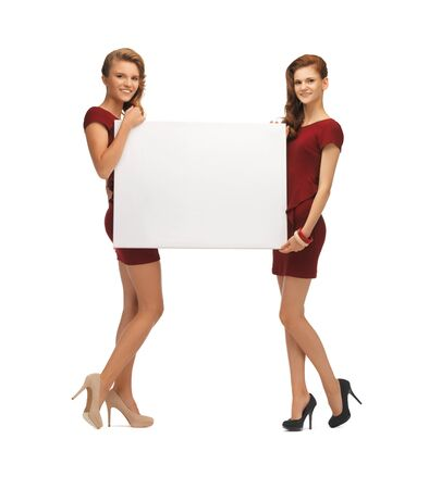 picture of two teenage girls in red dresses with blank board Stock Photo - 16880154