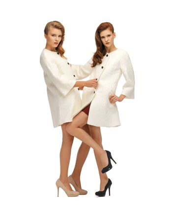 picture of two lovely teenage girls in white coats Stock Photo - 16880126