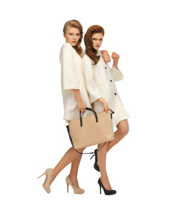 picture of two teenage girls in white coats with bag Stock Photo - 16880135