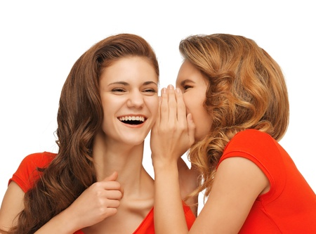 picture of two talking teenage girls in red t-shirts photo