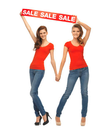 two teenage girls in red t-shirts with sale sign Stock Photo - 16880096