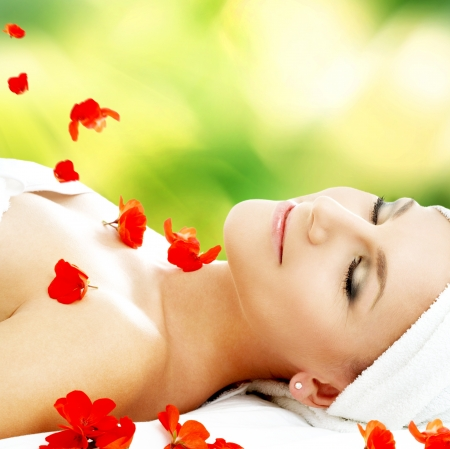lovely woman with red flower petals in spa Stock Photo - 16955170