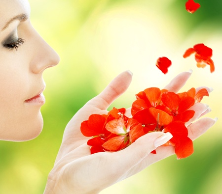 lovely woman with red flower petals in spa Stock Photo - 16879237