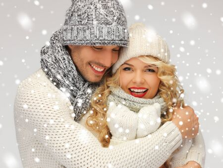 bright picture of family couple in a winter clothes Stock Photo - 16879270