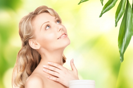 picture of beautiful woman with moisturizing creme photo