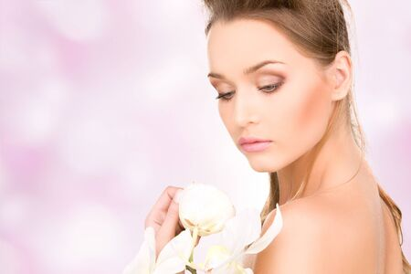 picture of beautiful woman with white flower Stock Photo - 16948597