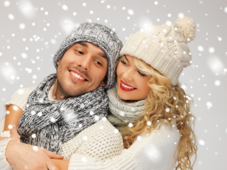 bright picture of family couple in a winter clothes Stock Photo - 16890575