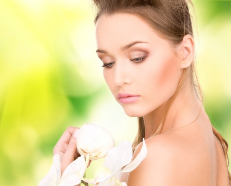 picture of beautiful woman with orchid flower Stock Photo - 16948619