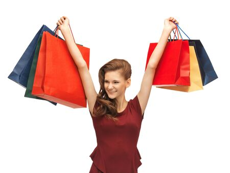 picture of teenage girl in red dress with shopping bags Stock Photo - 16948624