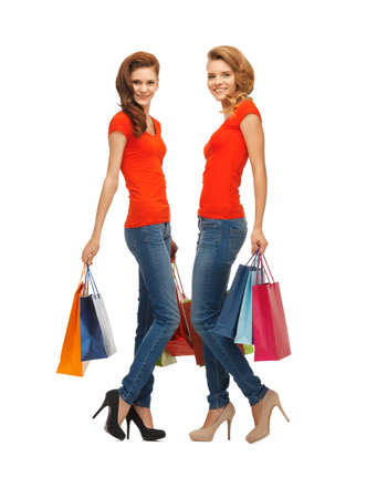 two teenage girls in red t-shirts with shopping bags photo