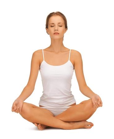 pranayama: sporty woman in cotton undrewear practicing yoga lotus pose