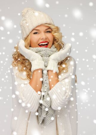 bright picture of beautiful woman in hat, muffler and mittens.. photo