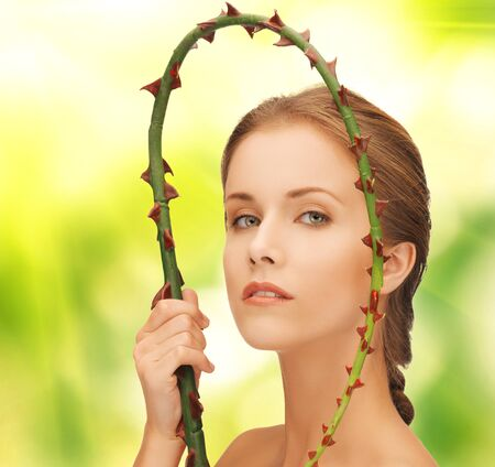 picture of lovely woman holding branch with thorns  Stock Photo - 16934629