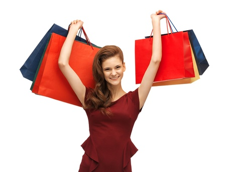 picture of teenage girl in red dress with shopping bags Stock Photo - 16909524