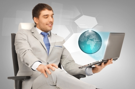 picture of businessman working with laptop and virtual screens photo