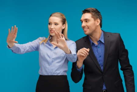 picture of man and woman working with something imaginary  Stock Photo - 16934628