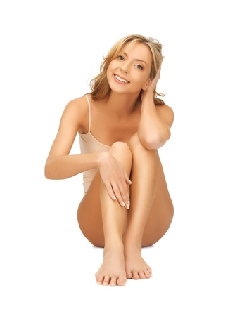barefoot women: picture of beautiful woman in cotton undrewear touching her legs Stock Photo