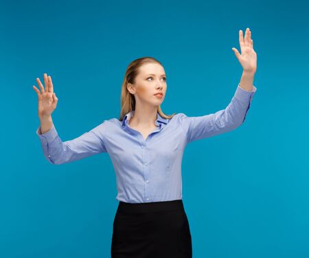 bright picture of woman working with something imaginary Stock Photo - 16937587