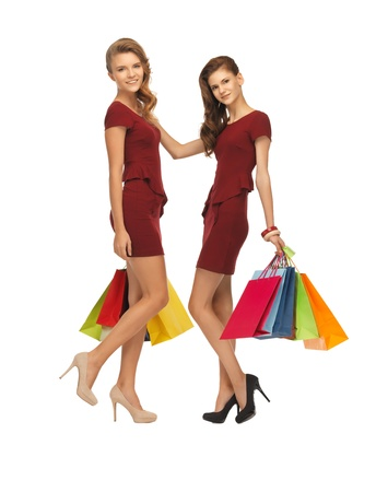 picture of two teenage girls in red dresses with shopping bags photo