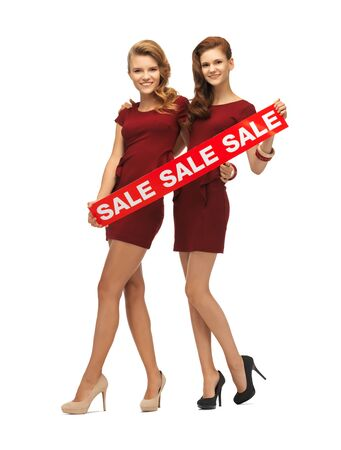 picture of teenage girsl in red dresses with sale sign Stock Photo - 16922762